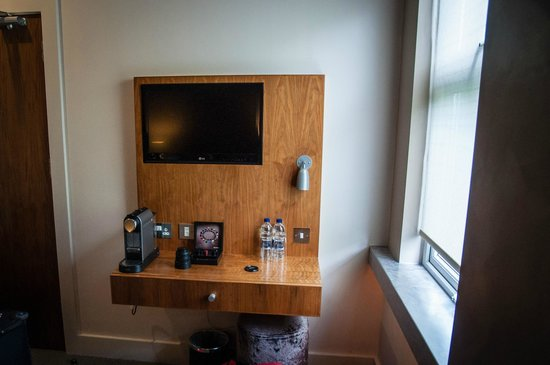 Hotel 55: TV shelf (Room 203)