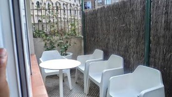 Grandom Suites: patio on the ground floor off the bedroom