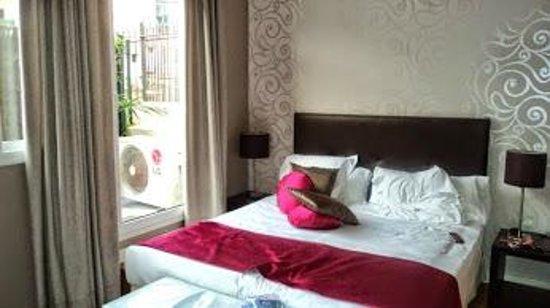 Grandom Suites: average patio bedroom, good size