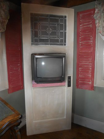 Inn by the Bandstand: clever placement of the tv in an old door