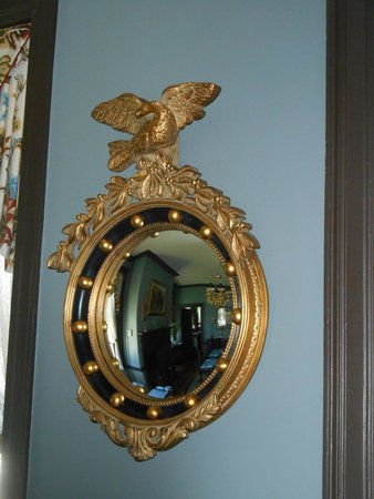 Inn by the Bandstand: bulls eye mirror in dining room