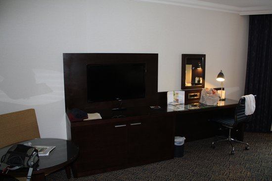 TV and desk in room at Grand Harbour Hotel