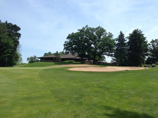 Bull's Eye Country Club: View of #18 green with clubhouse in the background