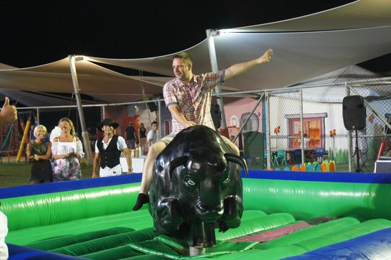 Papillon Belvil Hotel: Idiot trying to ride a bull (Me)