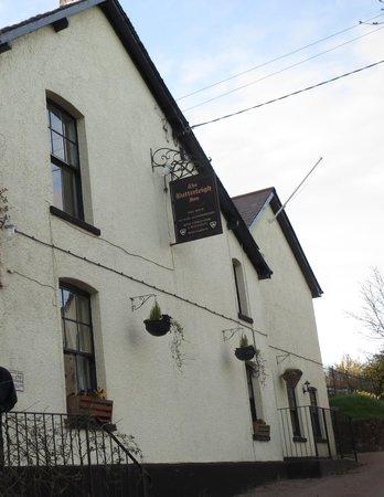 The Butterleigh Inn: Street view of inn with sign