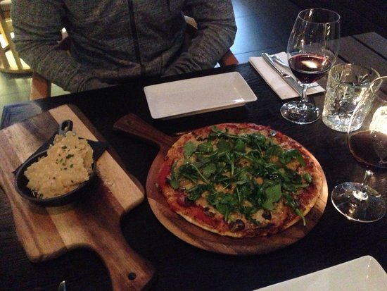 Miss Moneypenny's: Yum!!! Best pizza on Hastings and great $22 lunch special - pizza with 2 drinks!  Parmesan cris