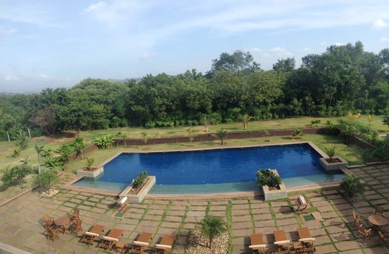 Hyatt Place Hampi : The view of the swimming pool from our room on the 4th floor.