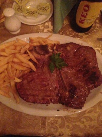 Olympus Palace Restaurant : Husbands T-Bone steak. Huge and so tasty