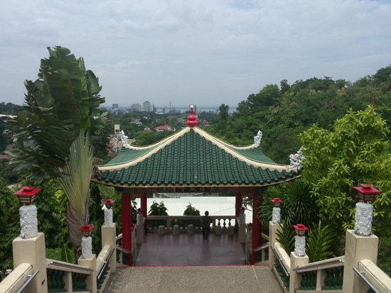 Taoist Temple: The descent with views of the city and sea in the background