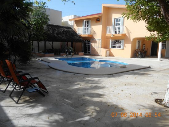 Hacienda del Sol: Patio/pool/portion of hostel/palapa/barbeque/pool chairs