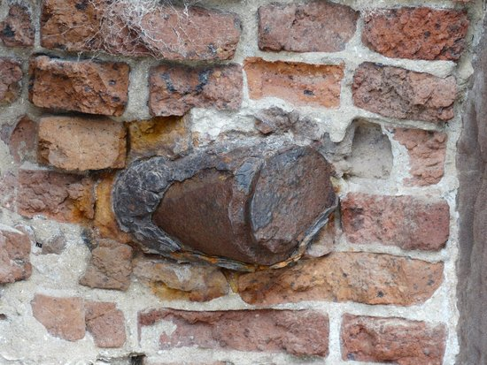 Fort Sumter National Monument: Leftover projectile embedded in wall.