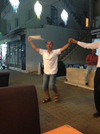 Golden Boys Restaurant : The owner even gets up and dances!!