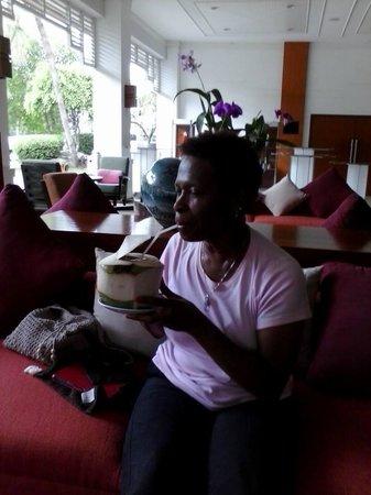 Amari Garden Pattaya: Enjoying coconut milk in Lobby Area.