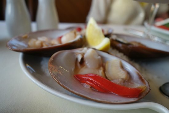 Lorenzillo's : The serve their clams on the half shell without the whole clam.