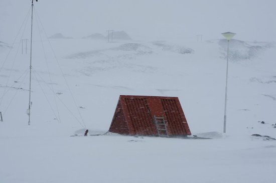 Krafla Lava Fields: A hut burried in the snow.