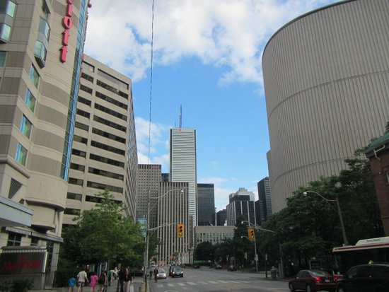 Marriott Downtown at CF Toronto Eaton Centre: View with the hotel on your left and the City Hall bldg across the street.