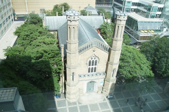 Marriott Downtown at CF Toronto Eaton Centre: View of Trinity Square and old church from a room.  Eaton Centre is in the background.