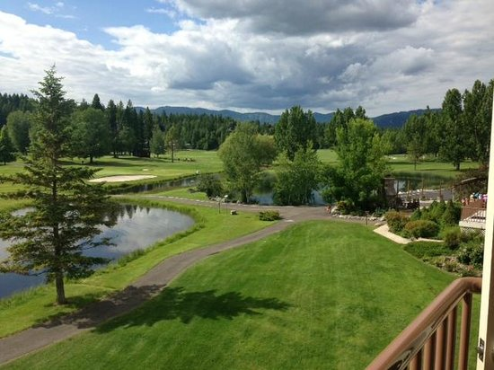 Columbia Falls, MT: View from the second floor hotel of golf course and peek at outdoor dining
