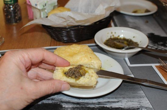 Curry Creek Cafe: Fresh roll/biscuit with an olive dipping bowl