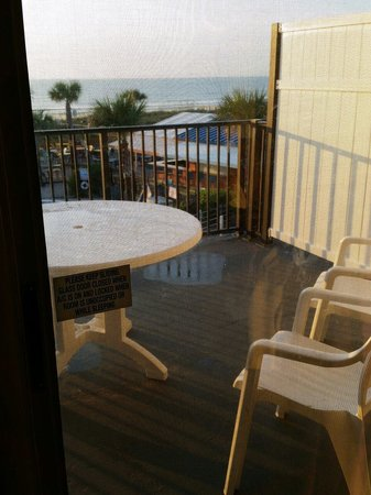 Seahorse Oceanfront Inn: large patio overlooking pool and bar and also the beach from the penthouse suite!
