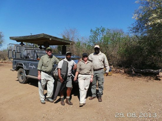 Singita Lebombo Lodge: Us with Chris our guide and Daniel our tracker.