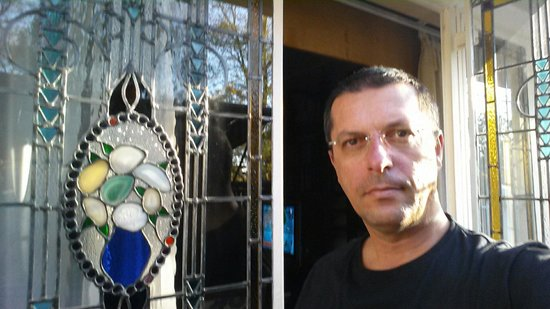 That's me in the balcony of Avalon Room #2. Nice glasswork made by the lady owner.