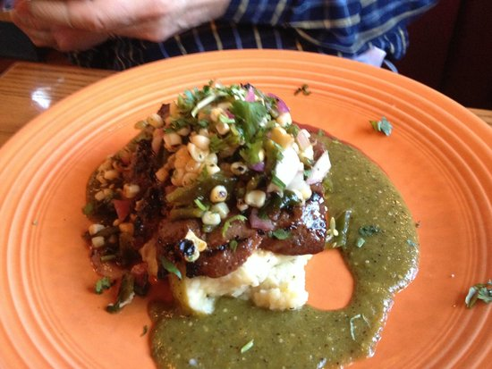 Kill Devil Grill: BBQ smoked flat iron steak with corn black bean salsa over mashed potatoes. I am ordering this!