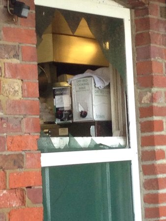 The Ship Inn: View of kitchen window with damaged netting
