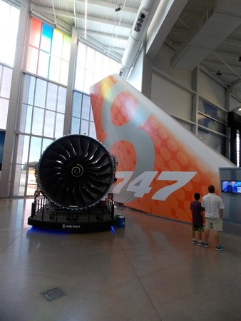 Future of Flight Aviation Center & Boeing Tour: A jet engine next to a 747-8 tail assembly