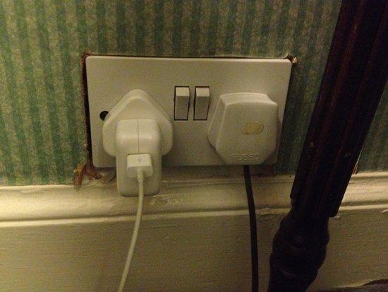 A-Haven Townhouse Hotel: Tatty decor around plug sockets.