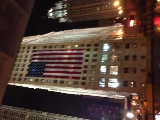 Shoreline Sightseeing : The American Flag on a building in Chicago