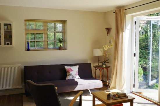 Blandy's Bed & Breakfast: A stylish and comfortable sitting room opens onto a secluded deck.