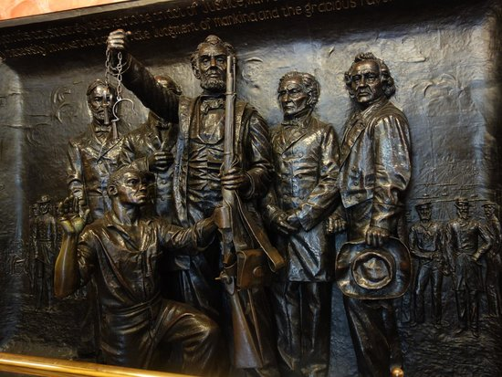 Soldiers' and Sailors' Monument: Abraham Lincoln freeing and arming a former slave