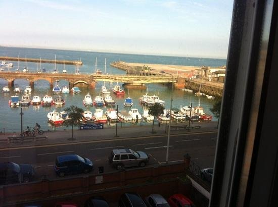 Grand Burstin Hotel: view from our window..one fishing boat named 'Squids Inn'.
