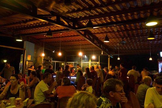 Cafe Agua Azul: Looking across the open-air restaurant toward the bar and grill area.