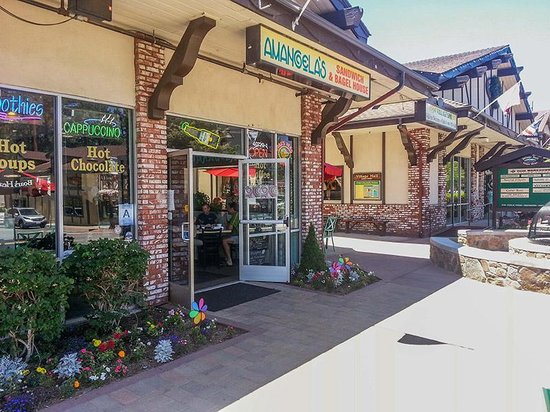 Amangela's Sandwich and Bagel House: Front entrance, outdoor seating around corner, right in heart of village