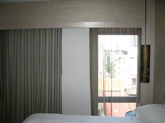 Naumi Hotel: View out of room, the LH curtain has no window behind it