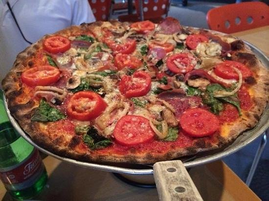 Tucci's Fire N Coal Pizza : Pizza with tomatoes, mushrooms, blue cheese, caramelized red onions and spinach.