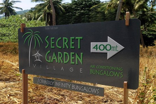 Secret Garden Village sign (on the Main road)