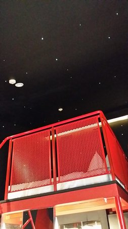 """Wanderlust: bed with view of """"stars"""" on walls."""