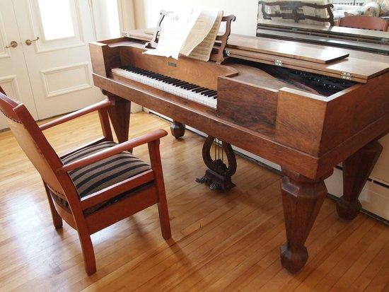 Chez Marie-Claire: Square grand piano in common area