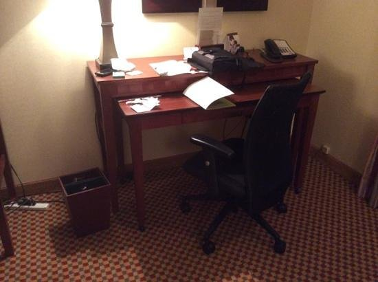 Doubletree Dallas Near the Galleria: See cords on bottom left of desk area. There are more under the desk area.