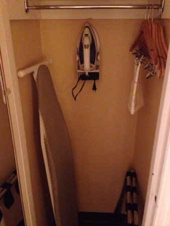 Garden Inn & Suites: Very small closet with iron and ironing table