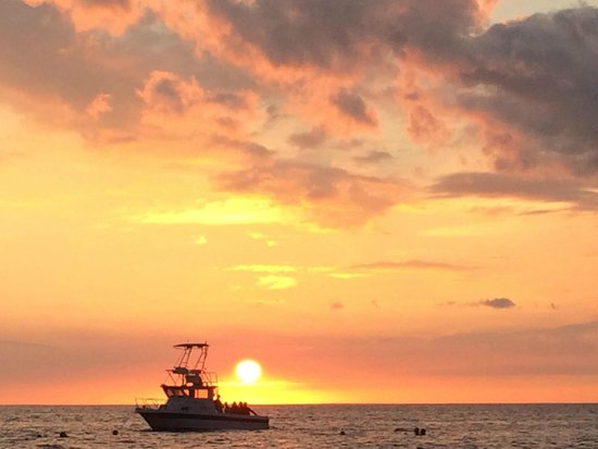 Coral Reef Snorkel Adventures : Sunset at Manta Ray site, our boat in the sunset