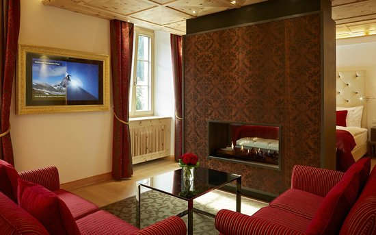 Grand Hotel Zermatterhof : Medium Suite Living with fire-place
