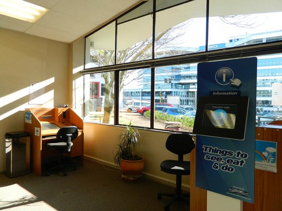 YMCA Hostel: VIEW OF INTERNET KIOSK(2) & INFO SCREEN FOR NEW ZEALAND