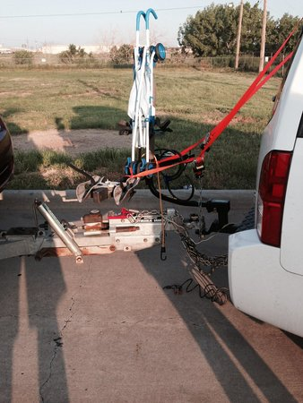 Days Inn Amarillo - Medical Center : Bike rack with straps cut, Heavy duty chains on ground and on the grass