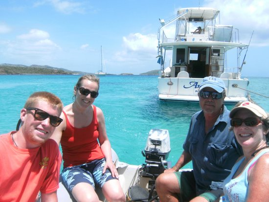 Pez-Vela Catamaran : Capt Bill escorting us by dinghy to beach by lighthouse