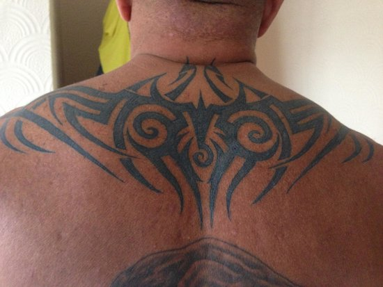Xperience St. George Homestay: Gun point tattoos, by George are amazing ��