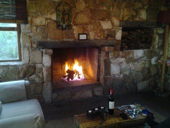 KolKol Mountain Lodge: indoor fireplace with endless wood
